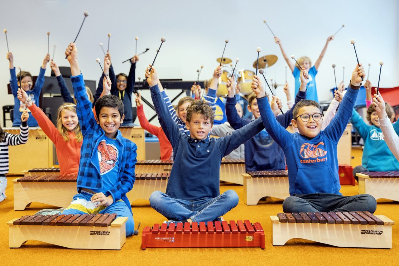 Primary School Students Playing Music