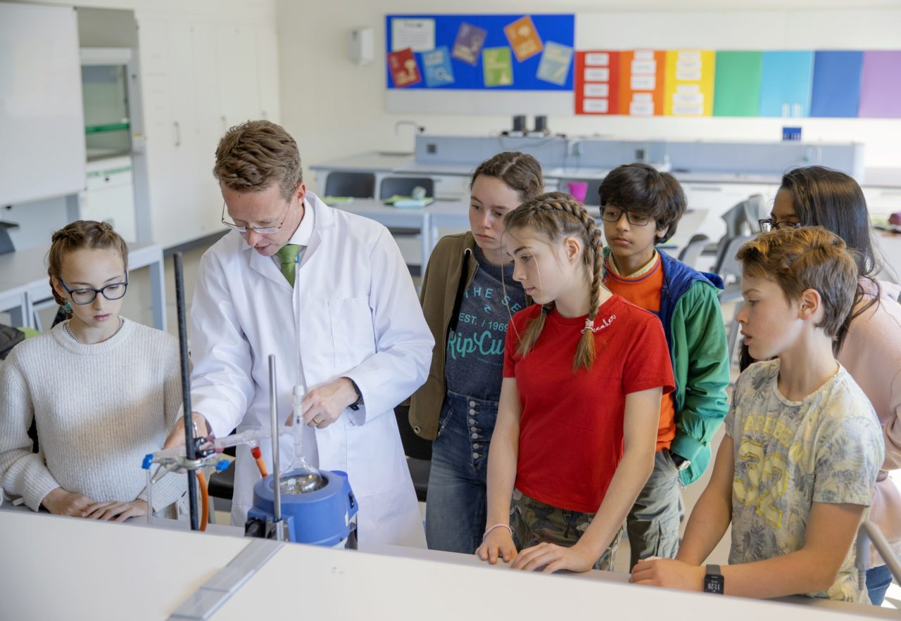 Students attending a science lesson at the International school of Lausanne